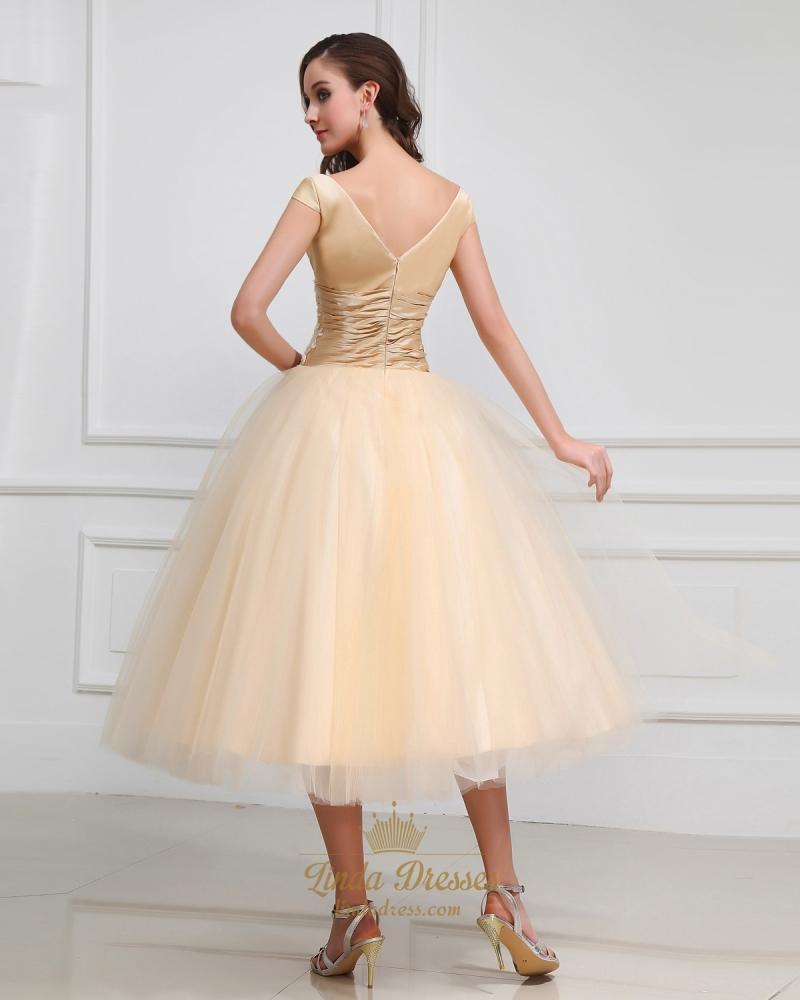 gold tea length dress