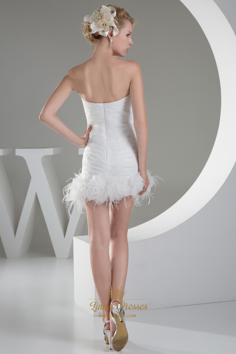 Ivory sheath beaded sweetheart wedding dress with feather for Wedding dress with feathers on bottom