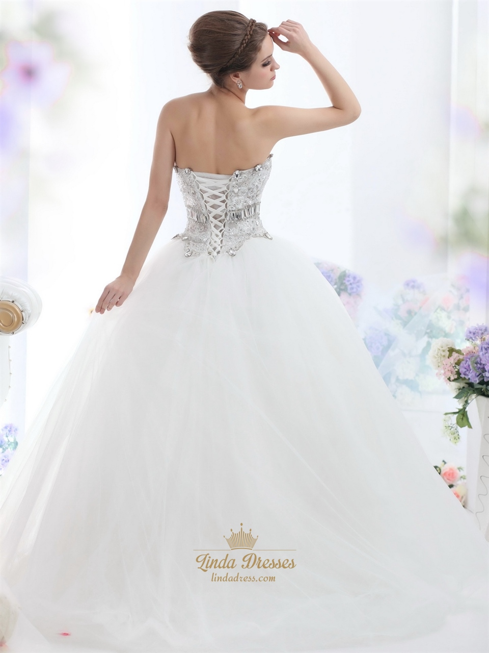Ivory strapless tulle ball gown wedding dress with for Strapless wedding dresses with bling