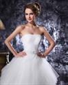 Show details for Elegant Ivory Strapless Tulle Beaded Wedding Dresses With Ruffled Skirt