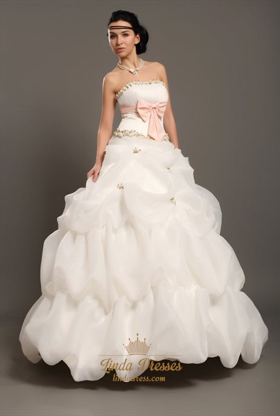 White Strapless Pick Ups Wedding Gown With Floral Embellishments