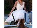 Show details for Lovely White Sleeveless V-Neck Short Lace Embellished Wedding Dress