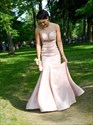 Show details for Light Pink Sleeveless Mermaid Long Evening Gown With Sheer Neckline