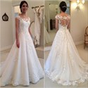 Elegant A-Line Cap Sleeve Lace Applique Wedding Dress With Sweep Train