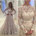 Show details for Illusion Lace Overlay Long Sleeve Wedding Dress With Cathedral Train