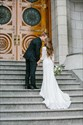 Show details for White V-Neck Floor Length Lace Wedding Dress With 3/4 Length Sleeves