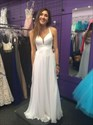Show details for White Sleeveless V-Neck Ruched Bodice A-Line Prom Gown With Cross Back