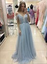 Show details for Sky Blue Spaghetti Straps Off The Shoulder Pleated Prom Dress